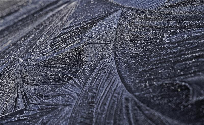 Early morning,Autumn Frost patterns on a car roof.jpg